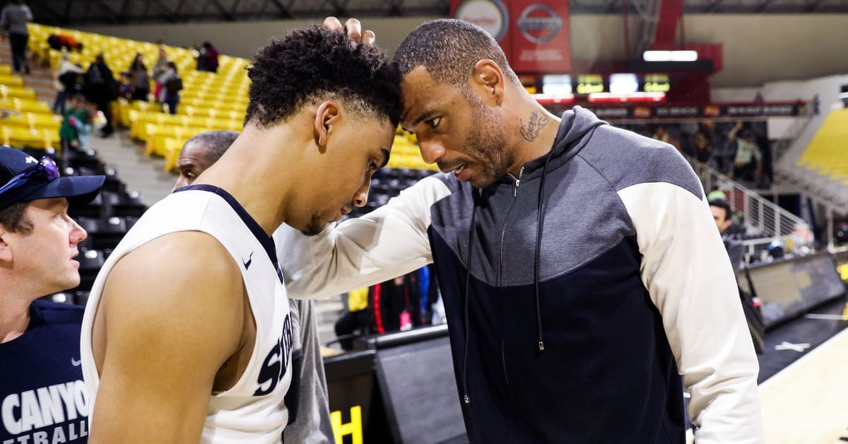 Kenyon Martin Jr. and his father.