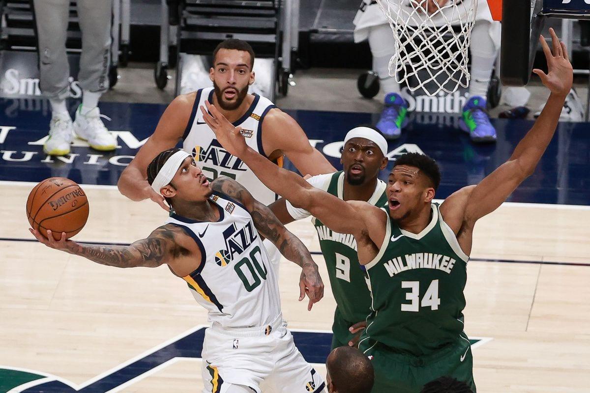 Giannis Antetokounmpo of the Bucks defending Jordan Clarkson